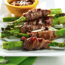Beef-Wrapped Asparagus Spears with Sesame and Chipotle Sauce