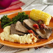 Grilled Cajun Chuck Roast with Spicy Cheddar Grits