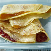 The versatile crépe is a thin pancake that is served rolled up or ...