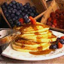 Whole-Wheat Buttermilk Pancakes with Maple Syrup and Fresh Berries