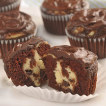 of cheesecake filling hides in each of these rich chocolate cupcakes ...