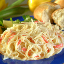 with lemon zest, a splash of cream and tossed with delicate angel hair ...