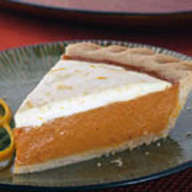 Zesty Cream Topped Orange Pumpkin Pie