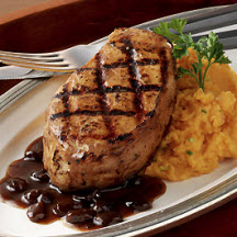 Grilled Jamaican Jerk Pork Chops with Raisin-Rum Sauce and Garlic Sweet Potatoes