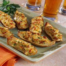 Cheesy Potato Skins with Sun-Dried Tomatoes